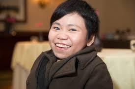 Jocelyn Wong poses for headshot.