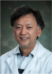 Dr. Tomatsu poses for a headshot.